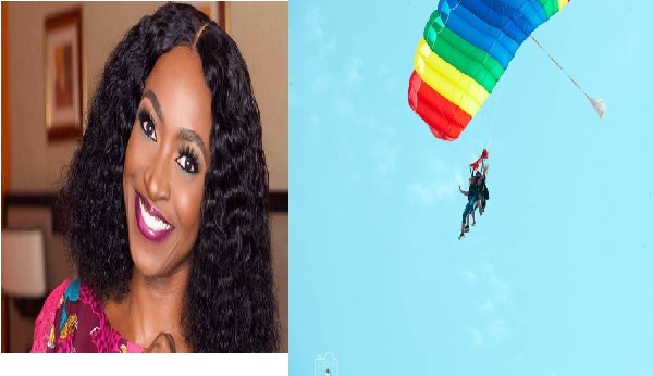 Kate Henshaw, seen, flying like a bird in the sky