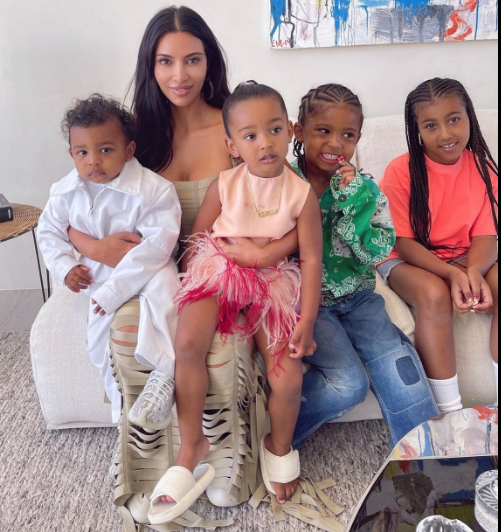 Kim Kardashian Has Her Hands Full with All Four Adorable Kids.