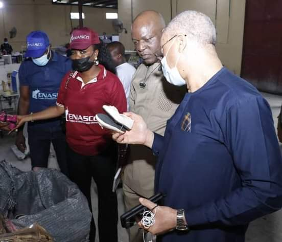 Pat Utomi Inspects Aba Automated Shoe Factory