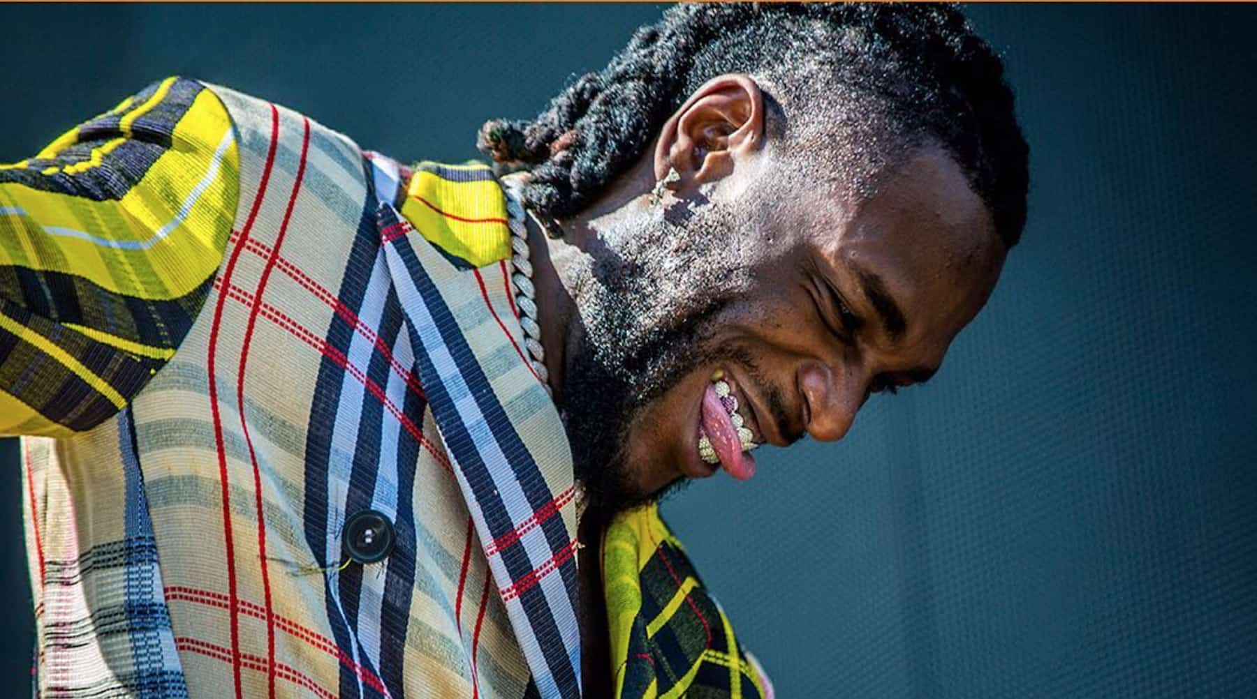 Burna Boy delivers on his promise to his parents as he receives his Grammy Plaque