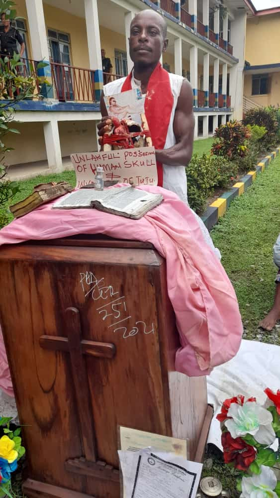 Disturbing Photos Of Pastor Michael Bassey Caught With Human Skull In His Church