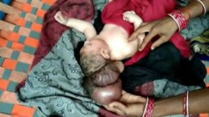 See Photo Of The Three-headed Baby Hailed As Incarnation of God Attracting Many Tourists