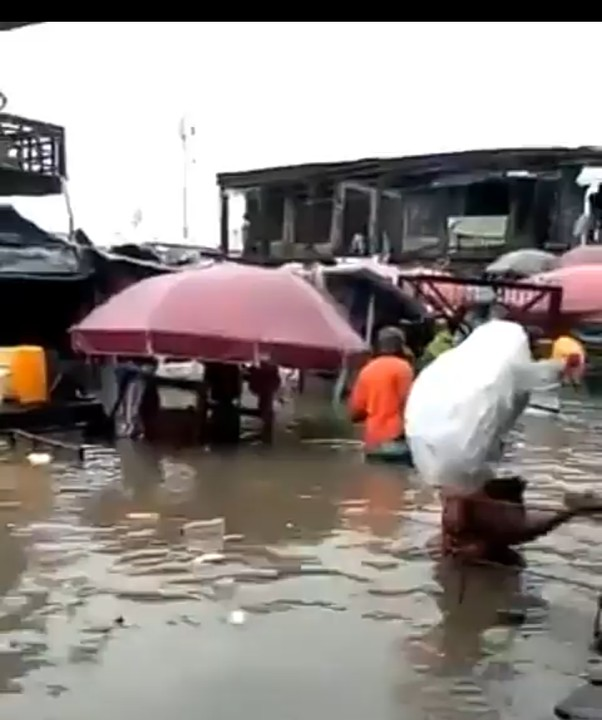 Residents Dancing Inside The Flooded Market In ABA Due To Rainfall